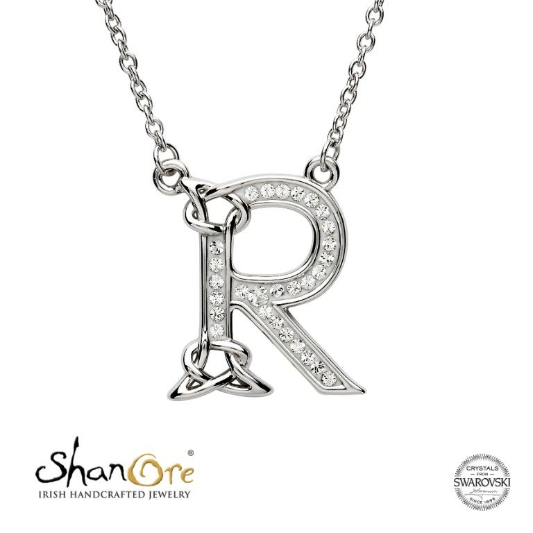 3e436bcebe5745 This elegant Celtic Name Initial Letter R pendant necklace is crafted in  Sterling silver and embellished with sparkling Swarovski® crystals for a  radiant ...