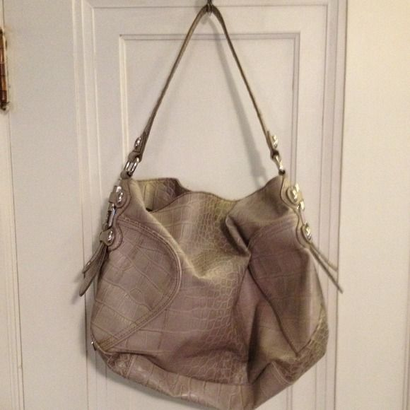 REDUCED Jessica Simpson bag Grayish taupe faux snakeskin bag with chrome details. Immaculate shape. Approximately 15 inches wide and 14 inches high. No trades, no PP, no holds Please make a *reasonable* offer! ✅Great deals on bundles!✅ Jessica Simpson Bags