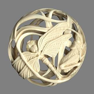 """Dragonfly and Grasshopper, Ryusa-style netsuke, 2006. Carved from ivory mammoth tusk, four amber inlaid eyes, 2"""" across and 1/2"""" thick. The loop for the cord was done opposite himotoshi 