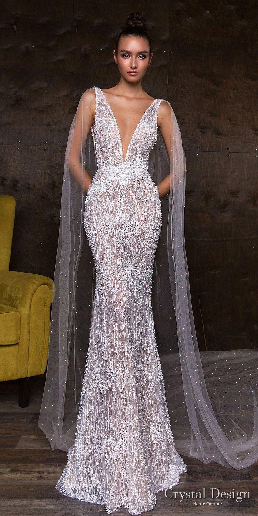 Simple elegant wedding dress designers  crystal design  sleeveless deep v neck full embellishment