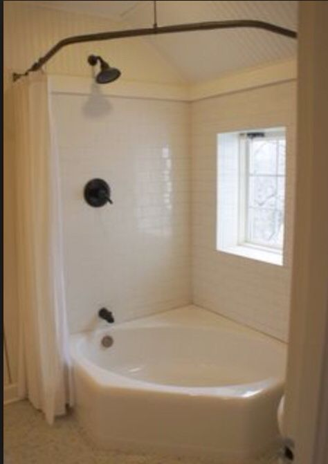 curved shower rod for our jacuzzi bath