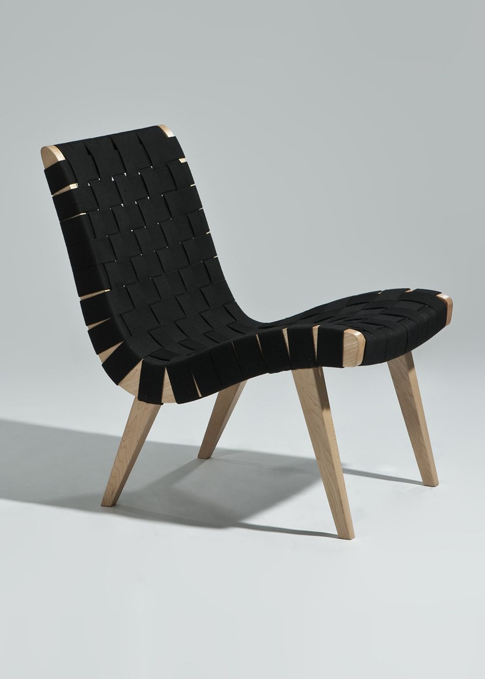 The Weaver Lounge Chair Is Solid Wood With A Woven Fabric