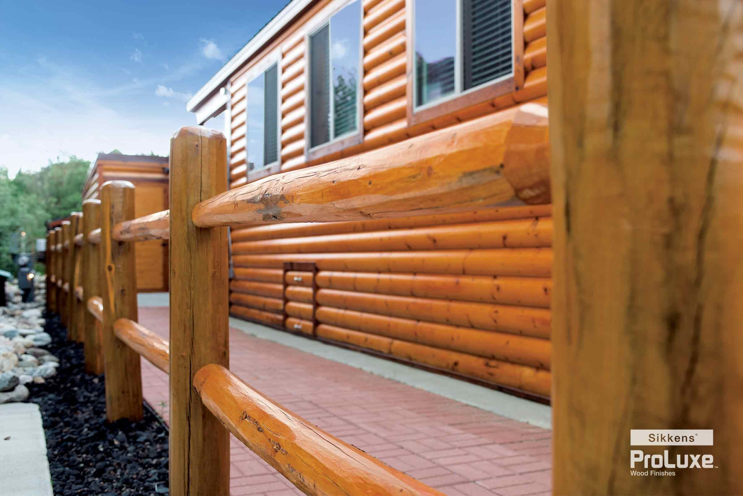 Sikkens Proluxe Cetol Log Siding In Natural Brings Out The Inherent Radiance Of The Knotty Pine Used On This Farm S Staining Wood Resort Cabins Log Siding