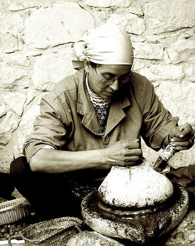Berber woman -    View On Black  Rural Morocco.  A Berber woman making Argan oil by traditional methods.  All true argan oil products are made by women's groups, th...