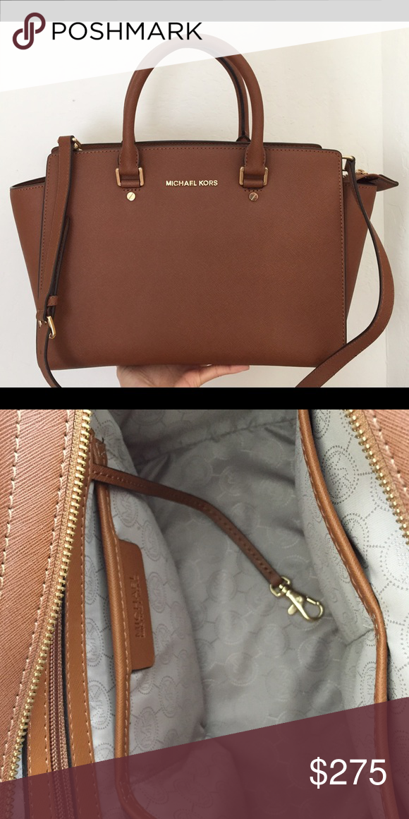 """Michael Kors Selma Large Satchel -100% Saffiano Leather  -Top Handle: 4.5""""  -Adjustable Strap: 17.5-19.5""""  -Interior: One Inside Zip Pocket, Two Open Inside Pockets  -14"""" x 9"""" x 3.5""""  -Top Zip  -100% Polyester Lining  -Imported Michael Kors Bags Satchels"""