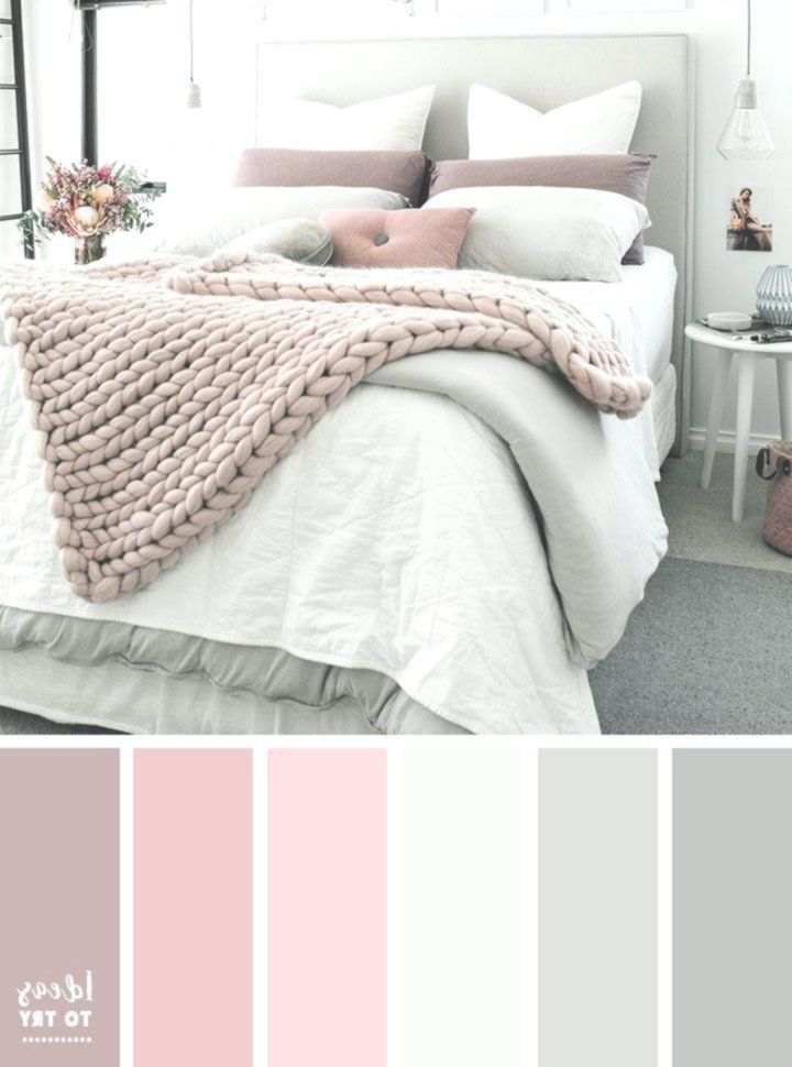 Pale pink bed room with picket furnishings and woven ...