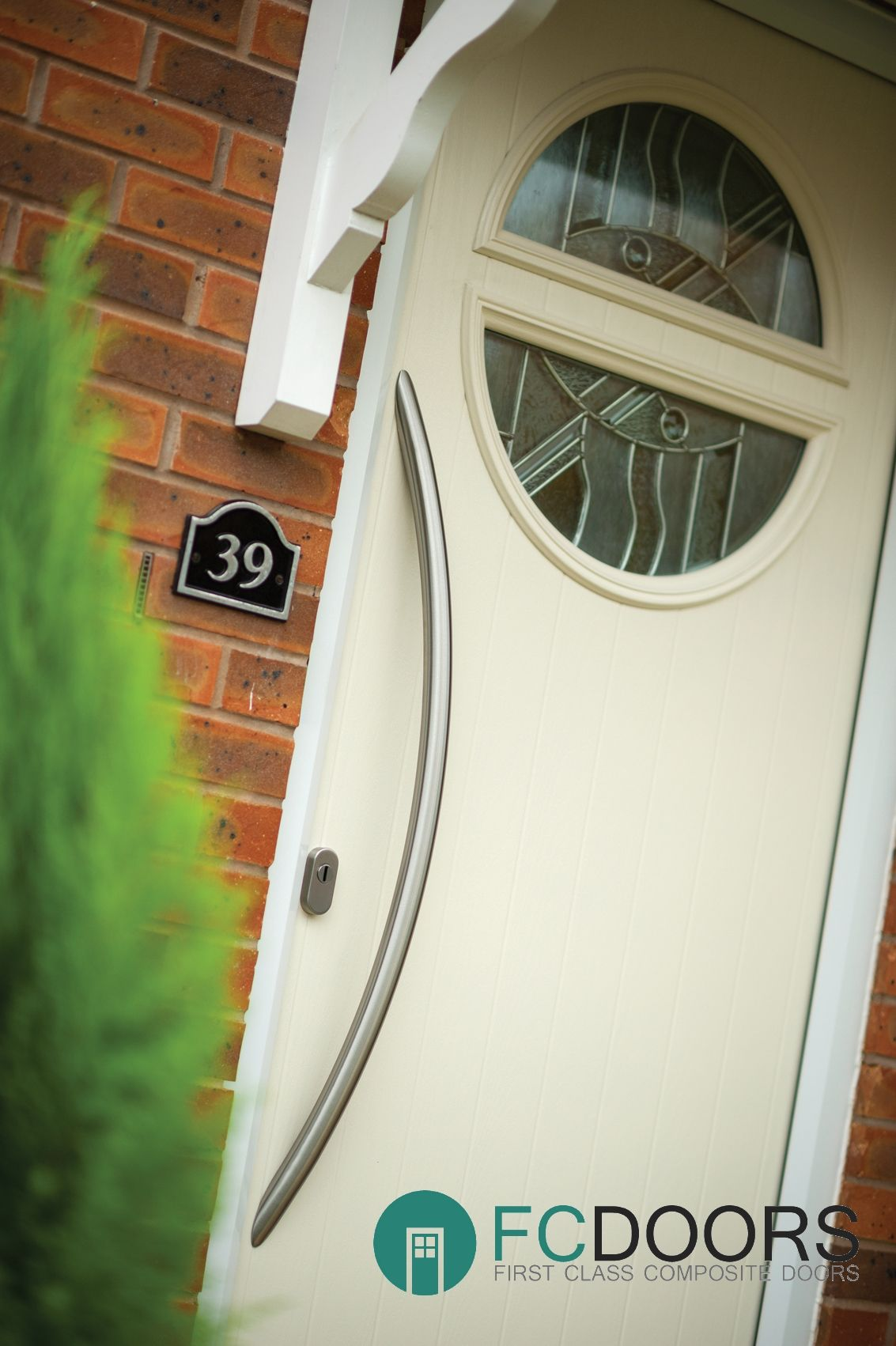 Contemporary Cream Circle Composite Door With A Long Bow Handle Making Your Home Unique And
