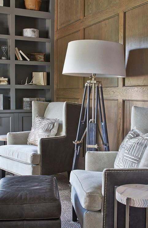 Wood Paneled Den: Masculine Den Features A Chic Tripod Floor Lamp Placed On