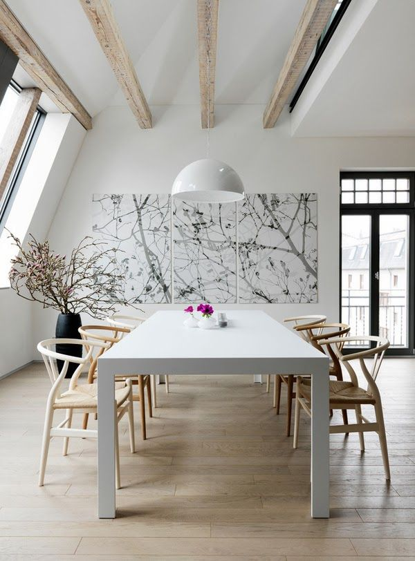 ChicDecó: modern loft in Germany. Dining room with white table and wishbone chairs