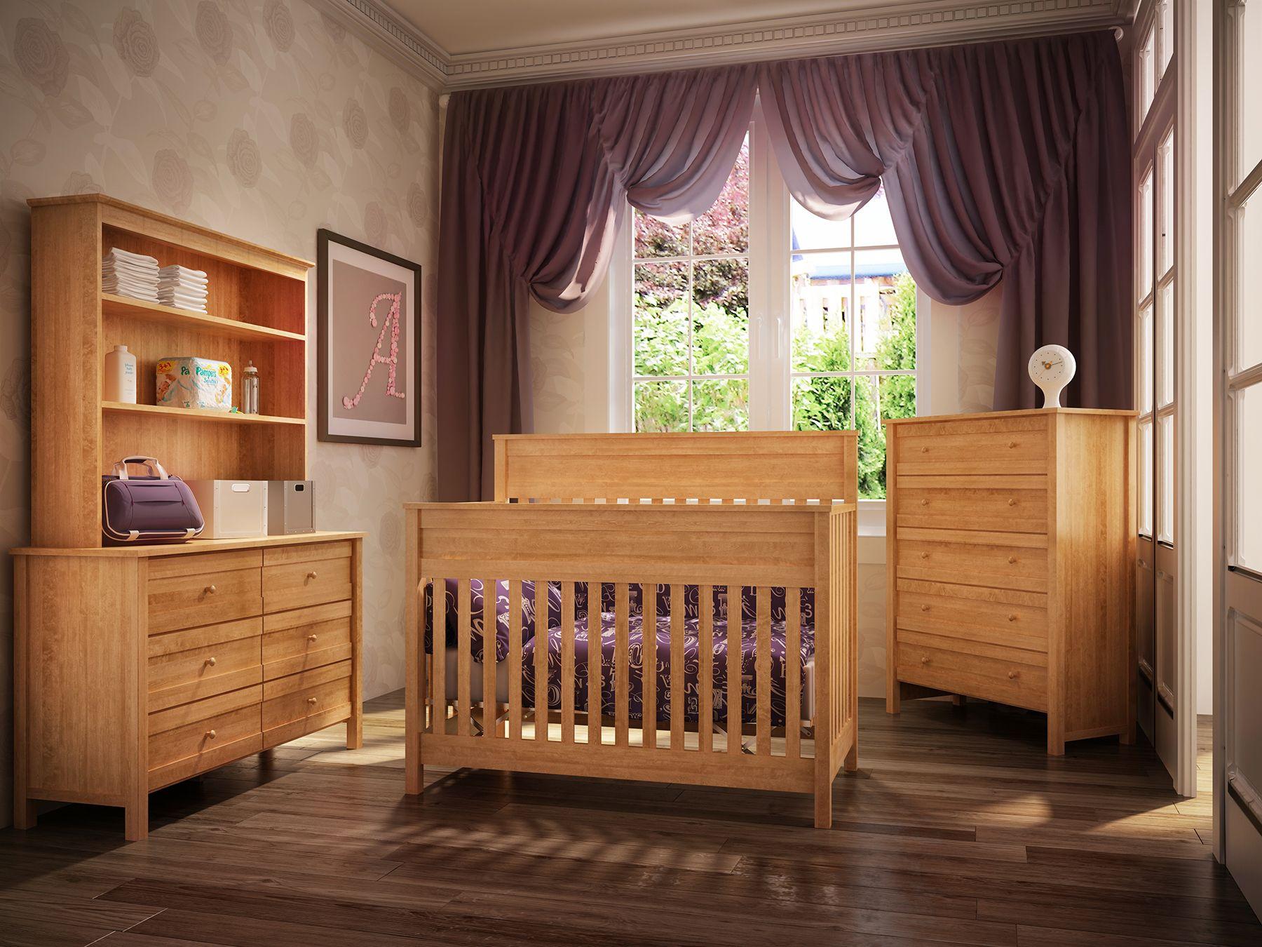 Chambre de bébé en bois franc clair.