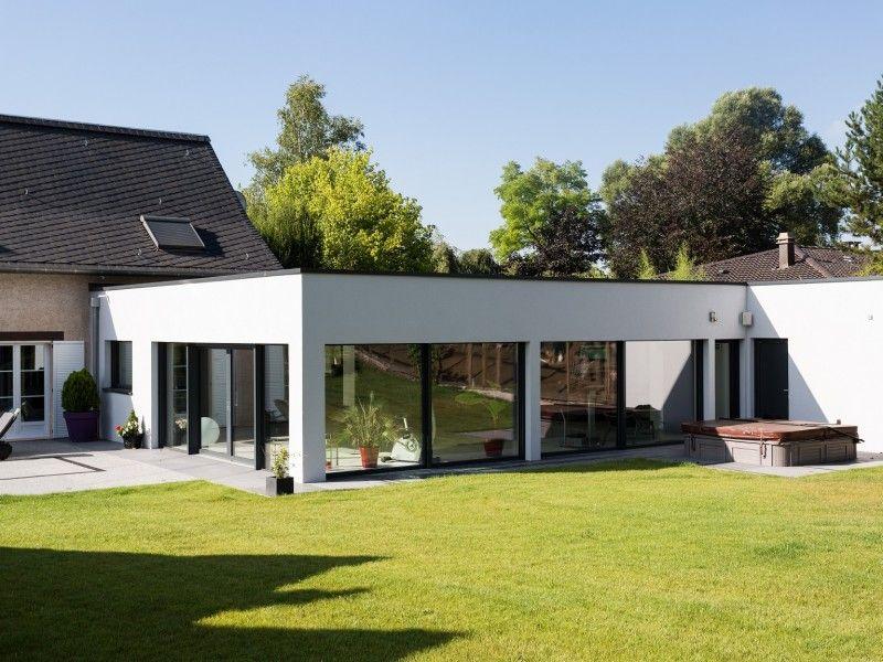 Magnifique extension bois avec piscine int rieure maison for Tarif construction piscine