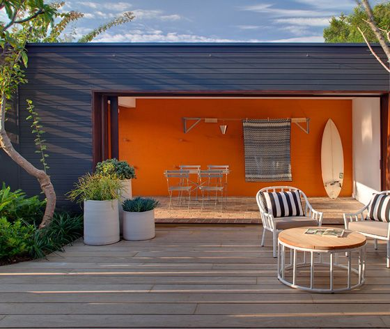 Dramatic cargo container conversion with contrasting colour palette