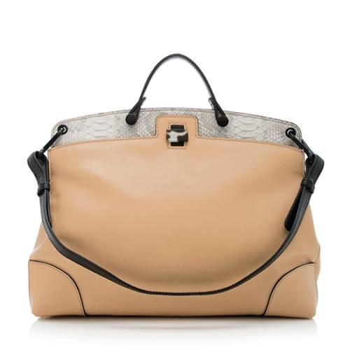 This Furla satchel is made from smooth beige leather with a white and grey snakeskin embossed top and black leather trim. Details include black metal hardware, a flat handle, back zip pocket, and a central turn-lock closure. The interior is fully lined with one open pocket and one zippered pocket. Carry this style on the forearm or over the shoulder with the detachable strap. PLEASE NOTE: Read condition carefully. This item is final sale. No returns or exchanges allowed on this item.