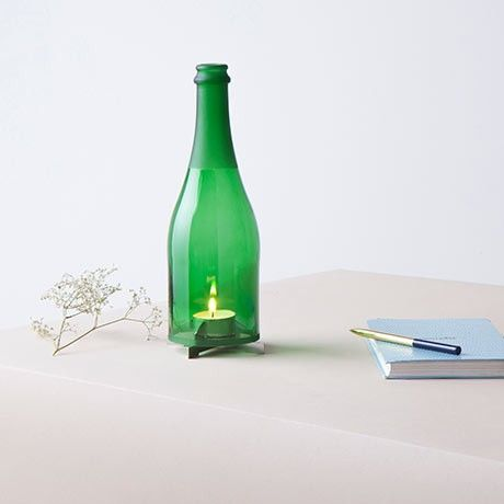 Bottle Holder - Champagne. Wind light made of recycled champagne bottle and stainless steel candle holder. Designed by LUCAS & LUCAS