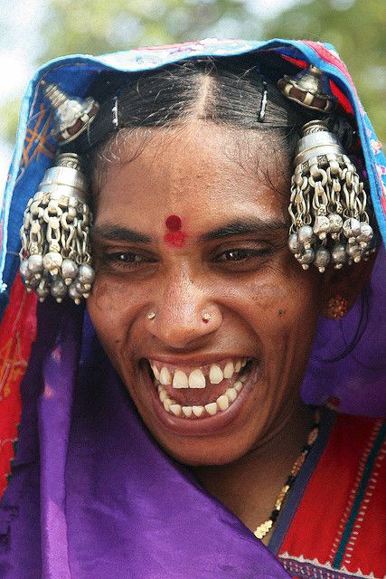 India | A Banjara women with a great smile on her way to a manifestation at Warangal. Andhra Pradesh | © Walter Callens.