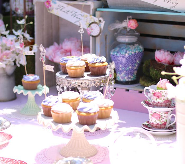 Fluffy, delicious cupcakes from Shabby Chic Alice in Wonderland Baby Shower at Kara's Party Ideas. See the whole party at karaspartyideas.com!