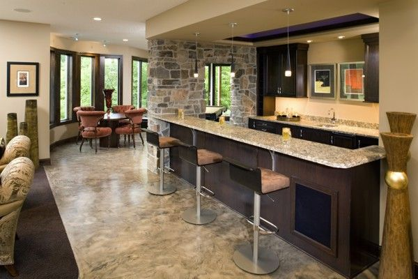 Basement Bar Design Ideas par lights can be used to illuminate the kitchen bar Check Out The Luscious Wet Bar Offset From The Spacious Rec Room And Game Room Wet Bar Designsbasement