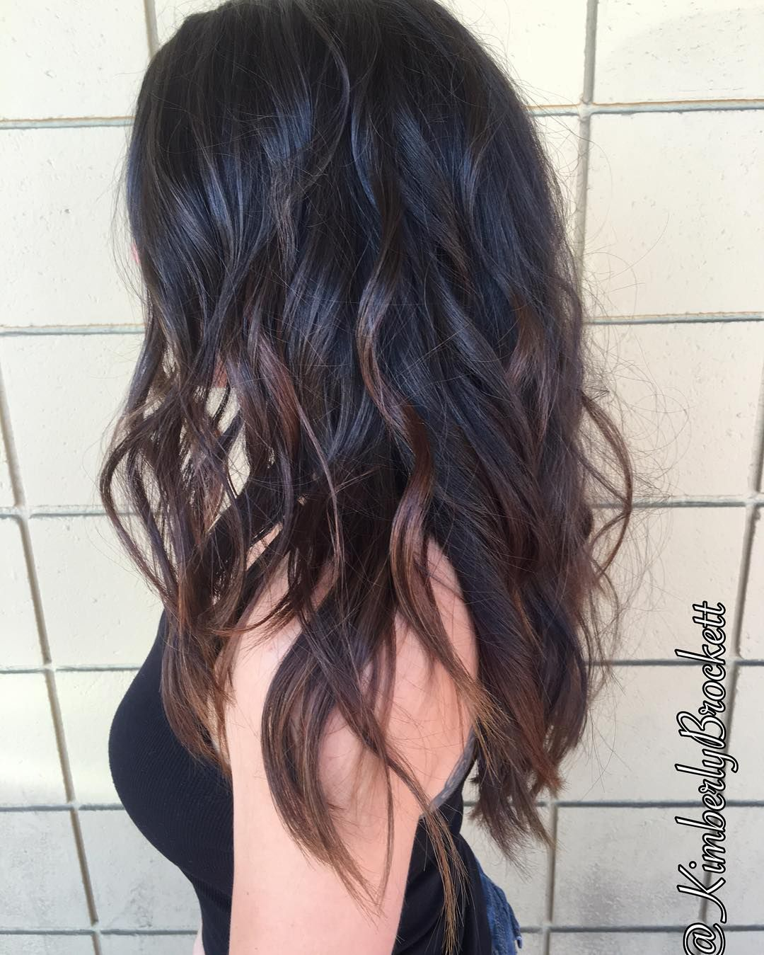 wavy black long layered hair with chocolate-brown balayage | long