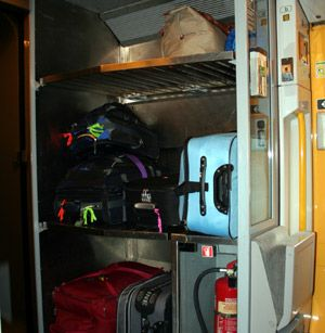 Luggage stack at the end of the coach on a typical train, in this