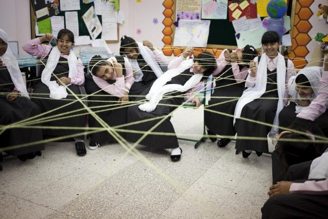 Sixth Grade students play a game at their first English lesson of the year at the Queeba Girls School in Ras Al Khaimah. Razan Alzayani / The National