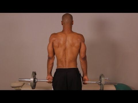 how to do a standing barbell shrug  home back workout for