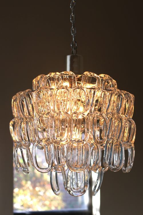 Cool chandelier -- the blog says there's a similar one at Design Within Reach.