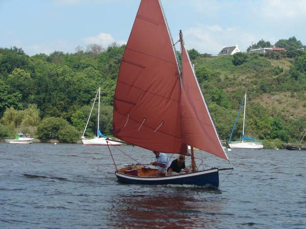 Clinker sailing dinghy with bowsprit built from a Fyne boat