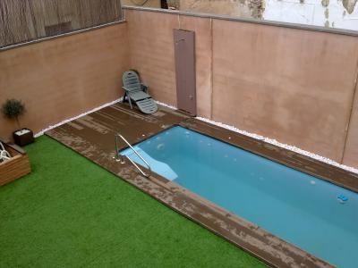 Piscinas prefabricada rectangular de fibra piscinas for Pileta en patio pequeno