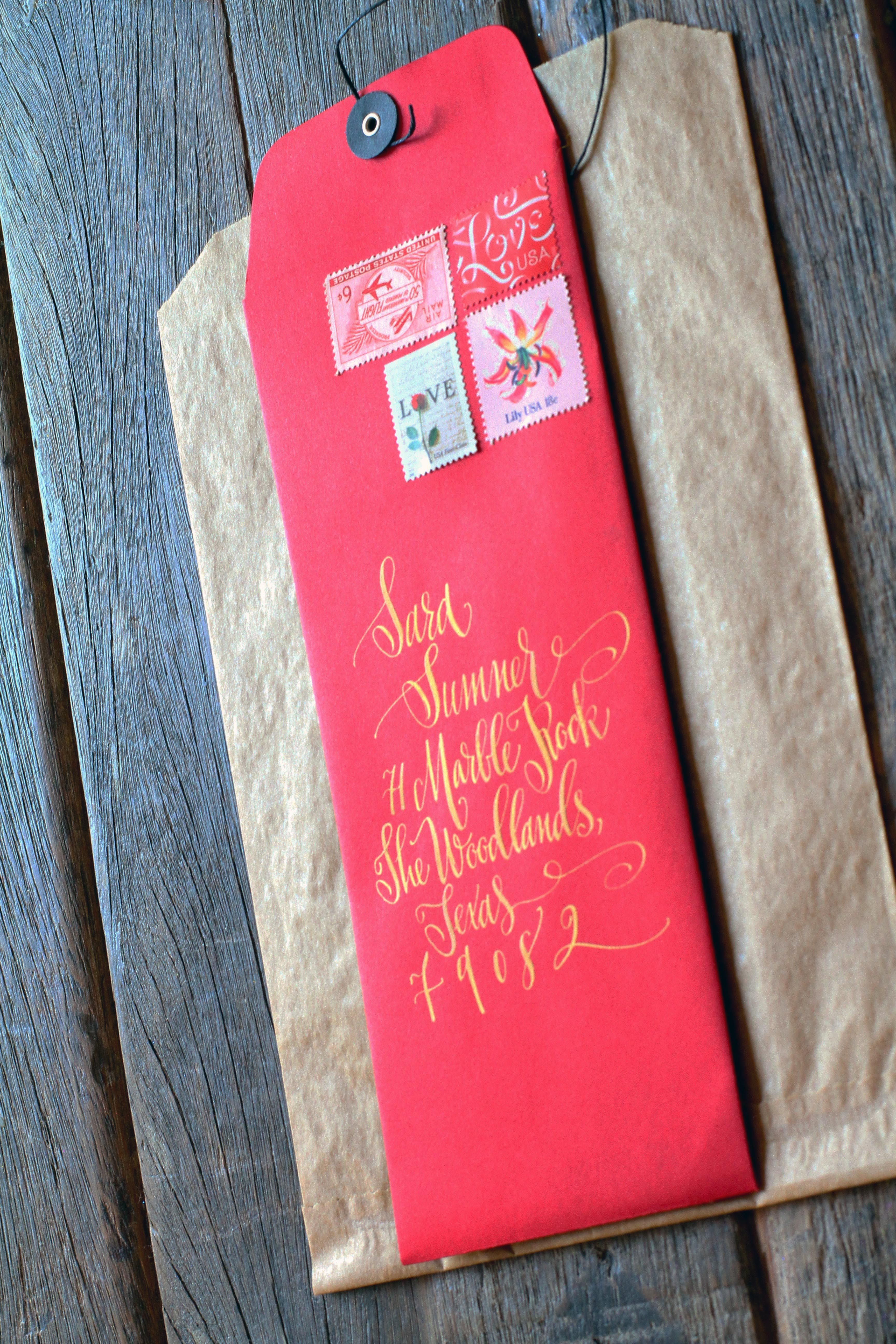 Red envelope with an assemblage of postage stamps and gold ...