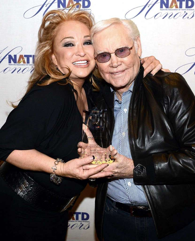 Tanya Tucker presents country music legend George Jones an award on Nov. 14, 2012 in Nashville. Photo: Rick Diamond, Getty Images / 2012 Getty Images