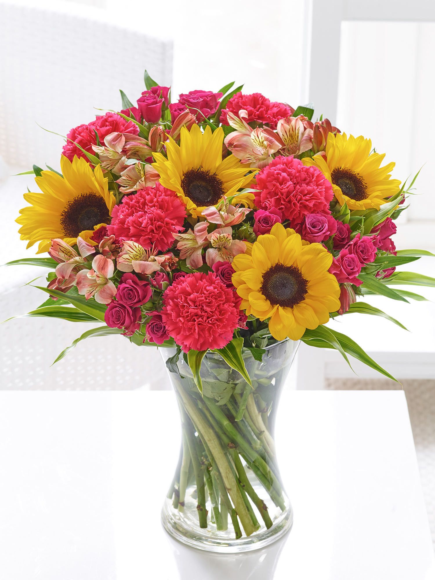 Fairtrade sunshine burst hand tied interflora stunning bouquets of flowers and flower arrangements hand crafted by experts and guaranteed to stay fresh for days izmirmasajfo