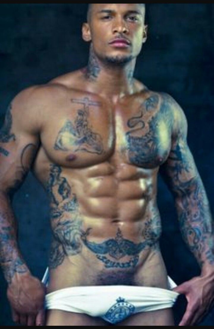 Muscle dudes in tats fucking