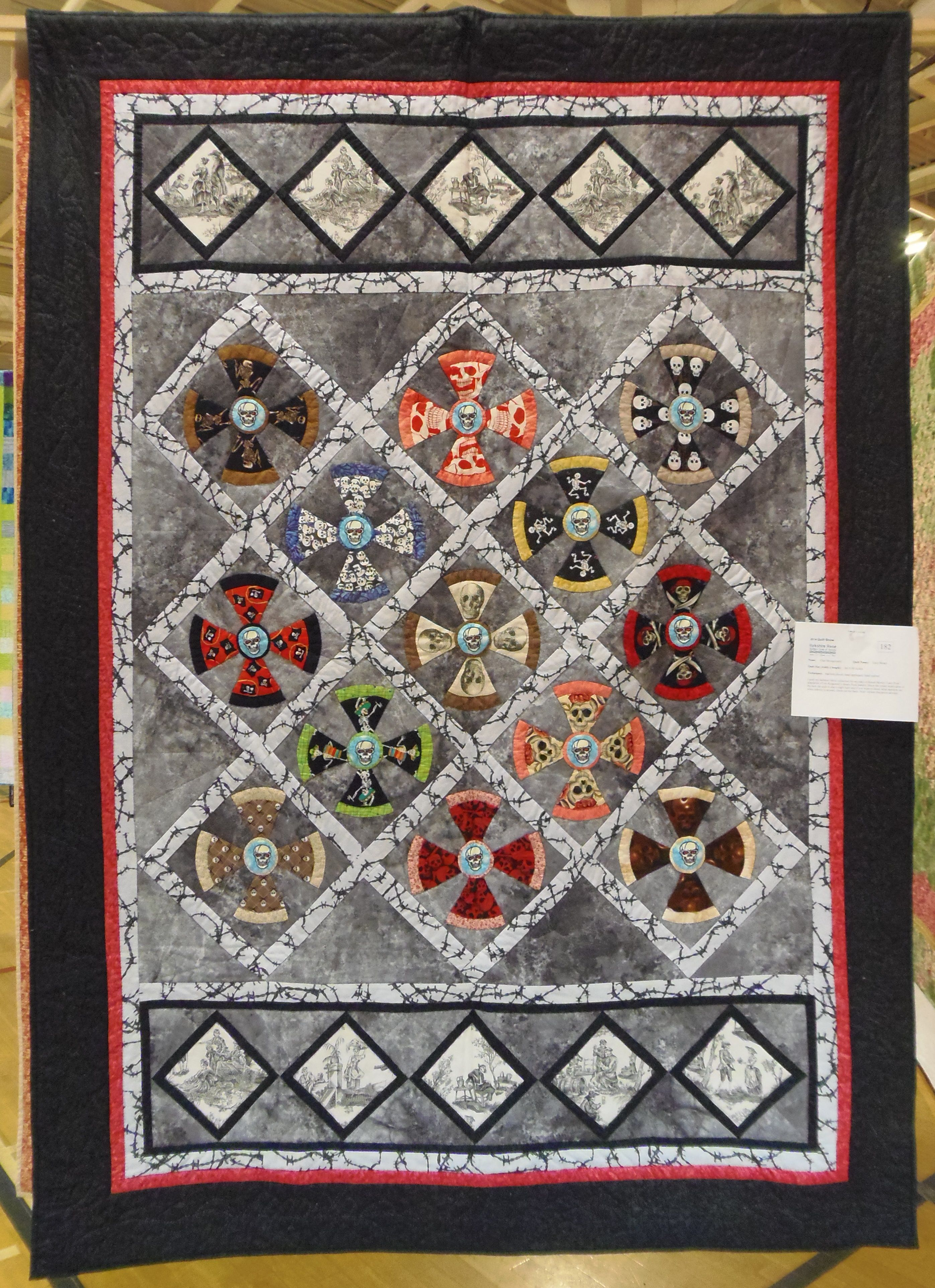 """This quilt is called """"Lazy Bones"""". It is made with skeleton prints. The border quilting is a lovely vine with the names of various bones!"""