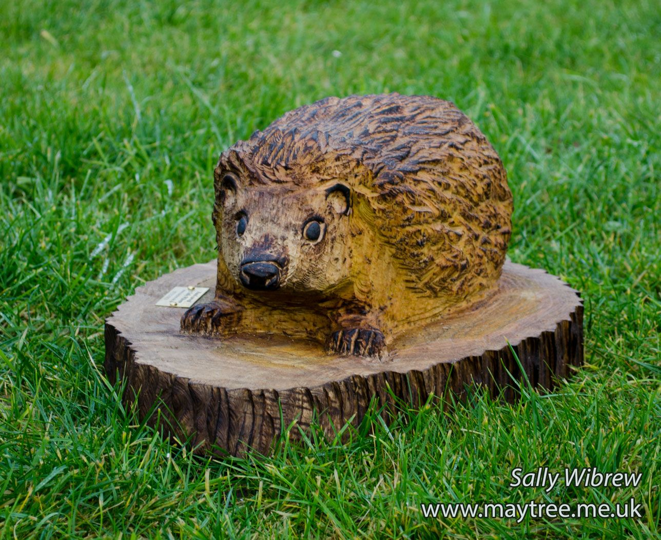 Another cute little hedgehog chainsaw carving that was a christmas