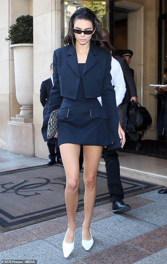 Kendall Jenner peels off her boxy blazer to unveil