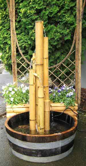 Bamboo fountain pond pinterest bamboo fountain for Bamboo water feature