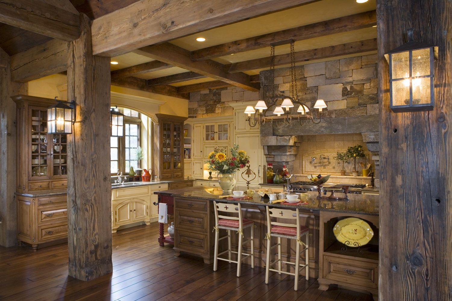 Rustic timber posts, wall sconces, wood floor, beam