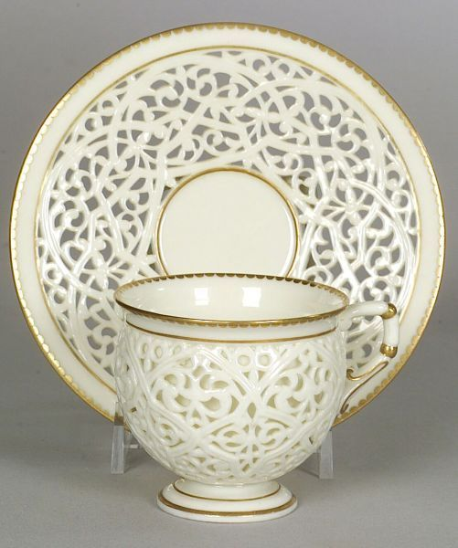 Grainger & Co. Worcester Porcelain Reticulated Cup and Saucer, England, circa 1885, each with gilt trim to pierced foliage and scrollwork