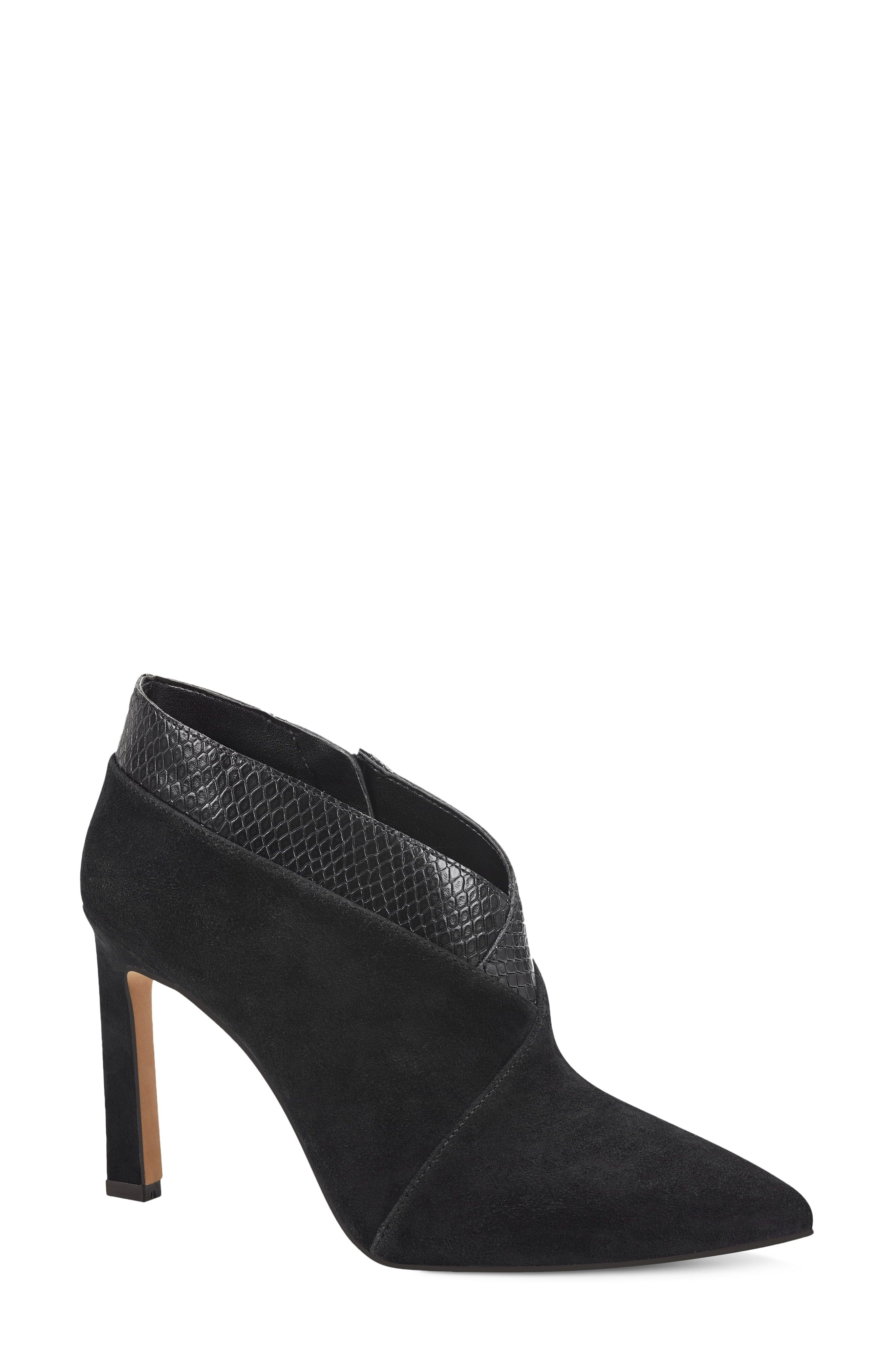 A pointy toe and lofty stiletto heel add scintillating modern style to this abbreviated bootie. Style Name:Vince Camuto Sempren Pointed Toe Bootie (Women). Style Number: 6122383. Available in stores.
