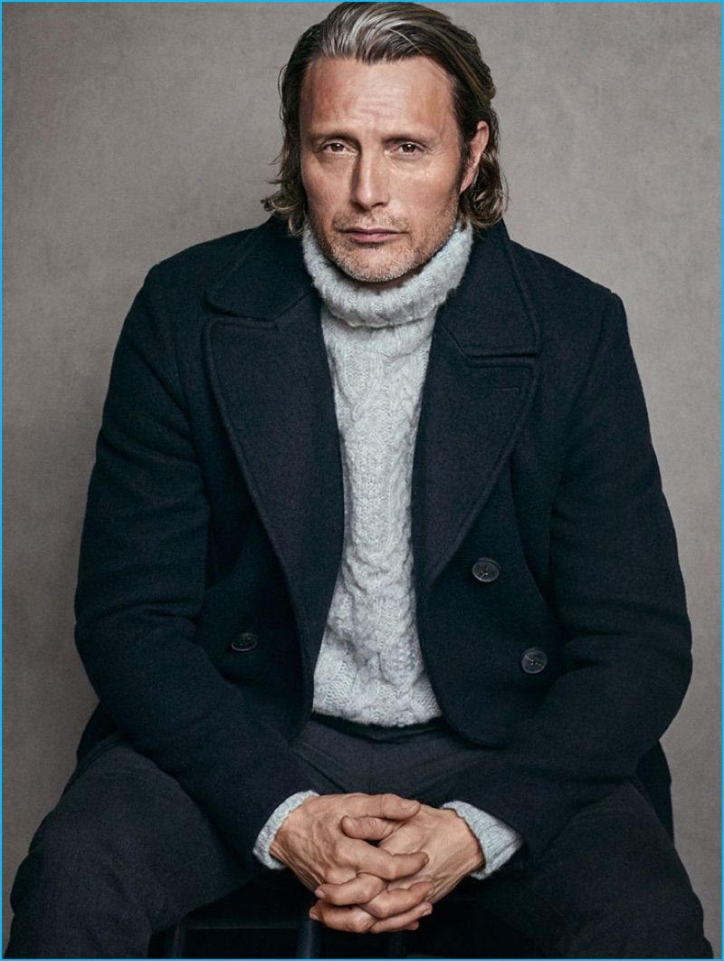 f3e68b5e473b2 Mads Mikkelsen wears a cableknit turtleneck sweater with a peacoat for Marc…