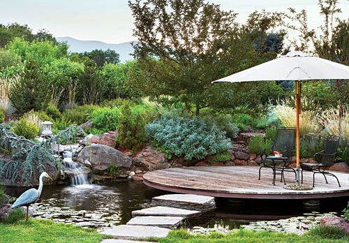 Suspended over a koi pond a circular redwood deck in for Circular garden ponds