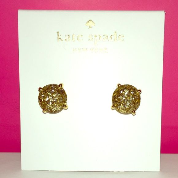 Kate Spade♠️GOLD Glitter Earrings NWTs ✨ Kate Spade ♠️Gold Glitter Gumdrop Earrings NWTs • Posts are made of Rhodium & are Nickel Free for sensitive ears • Includes dust bags • smoke free home • bundles get 15% discount • 20% donated to the American Cancer Society • IF INTERESTED LET ME KNOW & I WILL MAKE YOU A NEW LISTING AS I HAVE 2 • Thanks & Happy Poshing! ✨ kate spade Jewelry Earrings