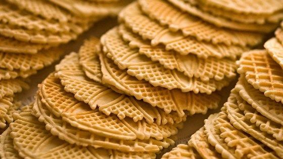 You must have a pizzelle iron to make these wafer thin cookies.  My pizzelle iron is the single cookie iron that you break into 4 triangles.