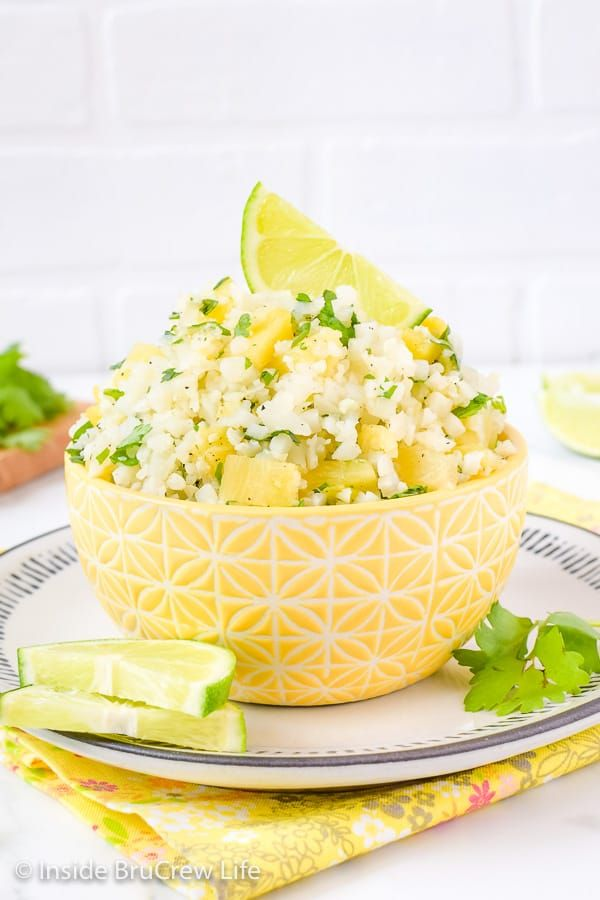 Pineapple Lime Cauliflower Rice - a bowl of this easy cauliflower rice gets it's flavor from pineapple, lime, and cilantro. Make this easy and healthy recipe to go with tacos, fajitas, fish, or grilled chicken.