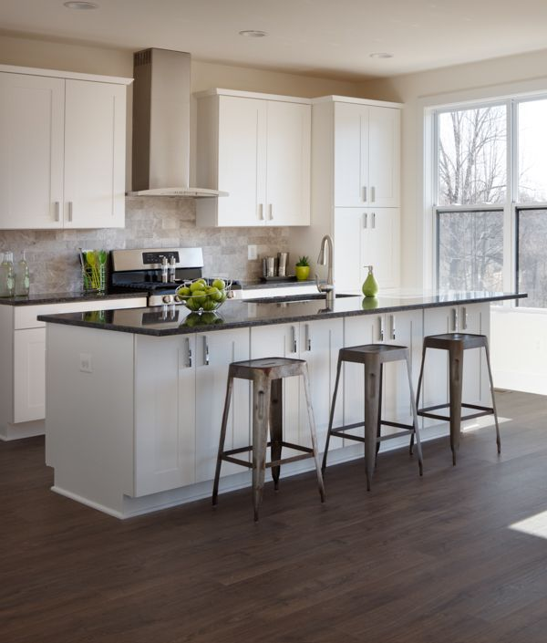 Light-filled kitchen with white maple cabinets and a ... on Light Maple Cabinets With White Countertops  id=14449