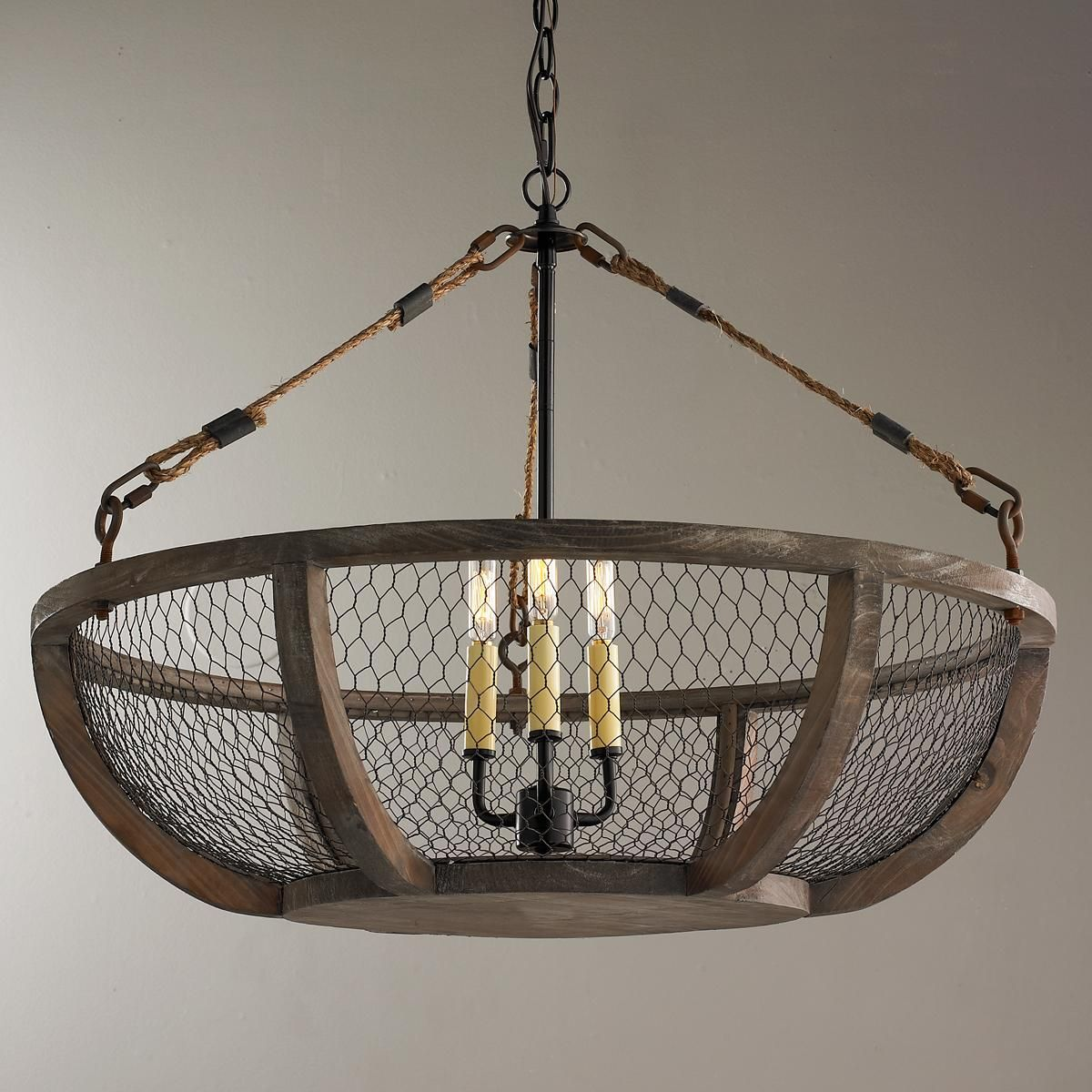 En Wire Basket Chandelier Mesh Wraps Around A Distressed Wood Frame For Country French