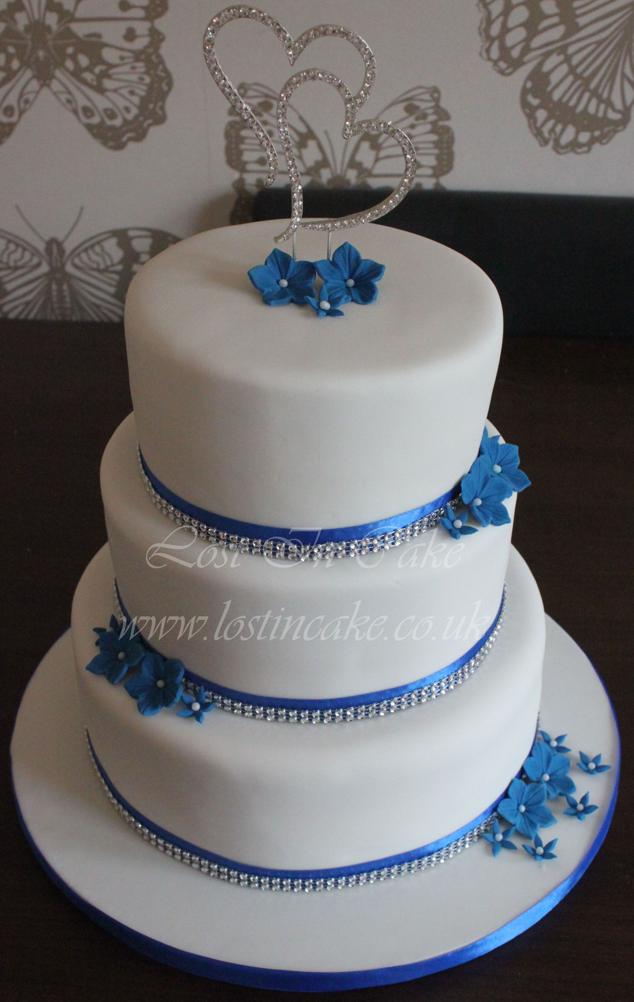 White and Royal Blue Wedding Cake with Diamante trim, topper and ...
