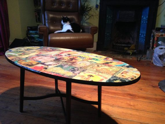 Cafe table treatment -  paint black and decoupage table top
