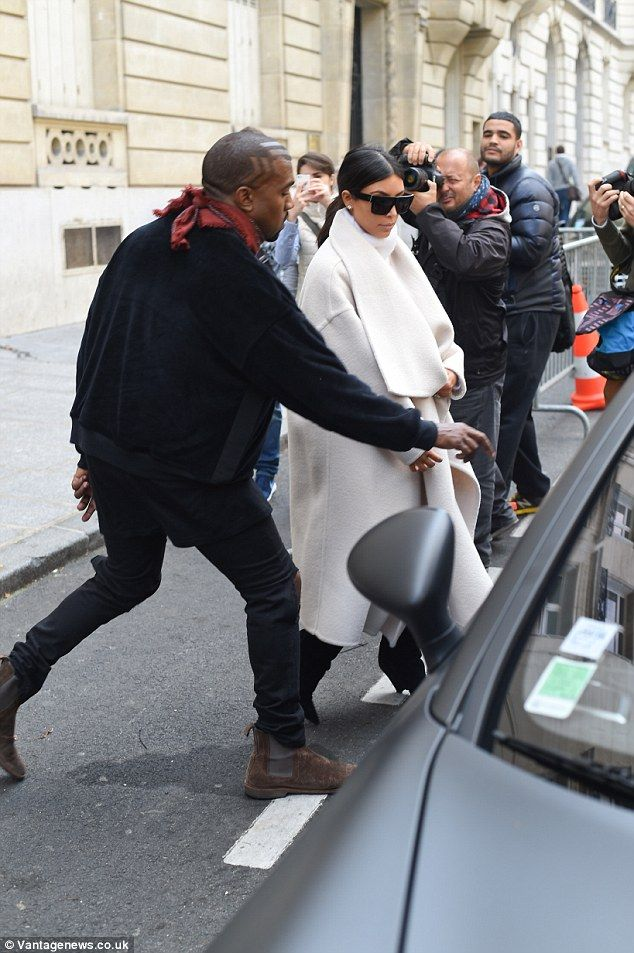 After you: Kanye was seen opening the door for his stunning wife as they made their way onto their next stop