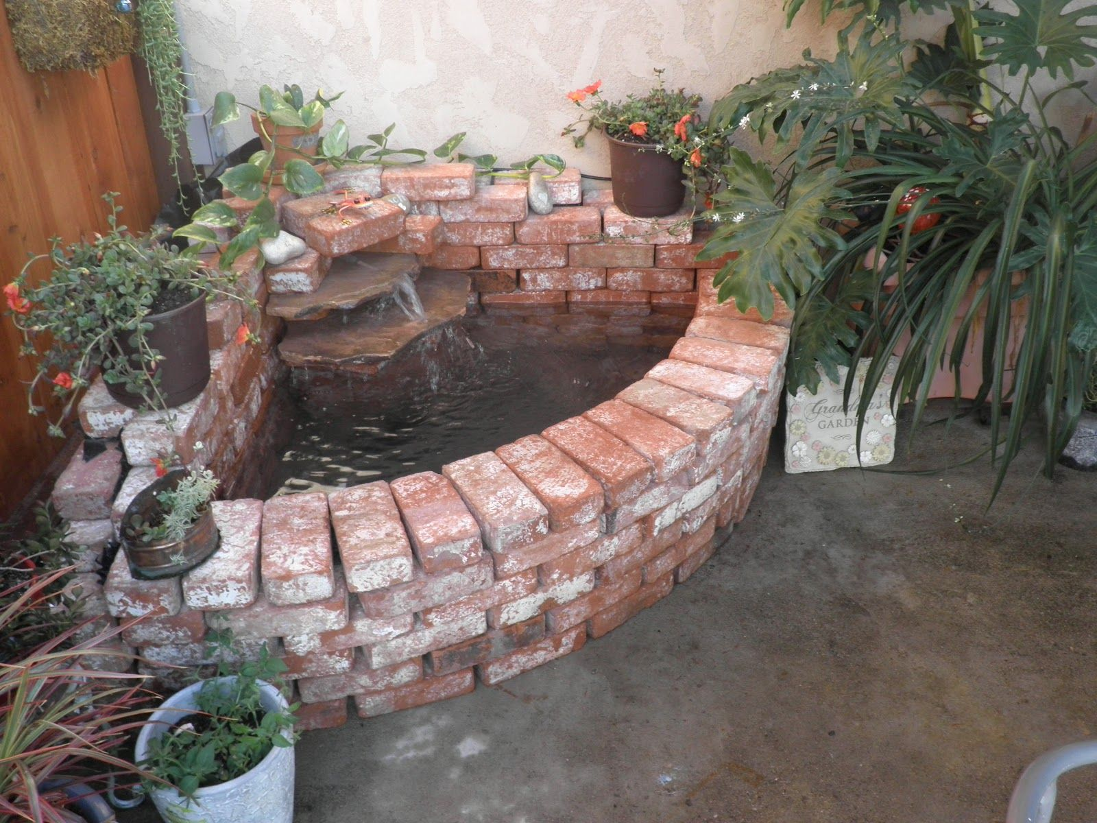 Brick pond idea the serenity of outdoors pinterest for Fish pond decorations